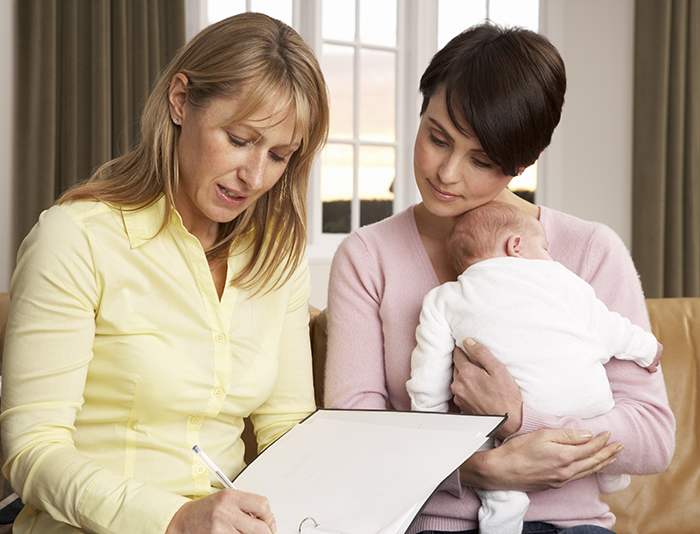 Mother and infant talking with professional